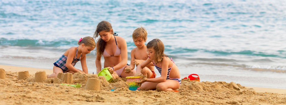 Family enjoying the Abama's private beach In Tenerife