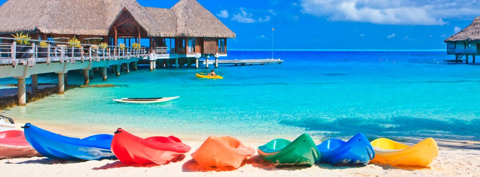 Maldives - colourful kayaks and stilted villas