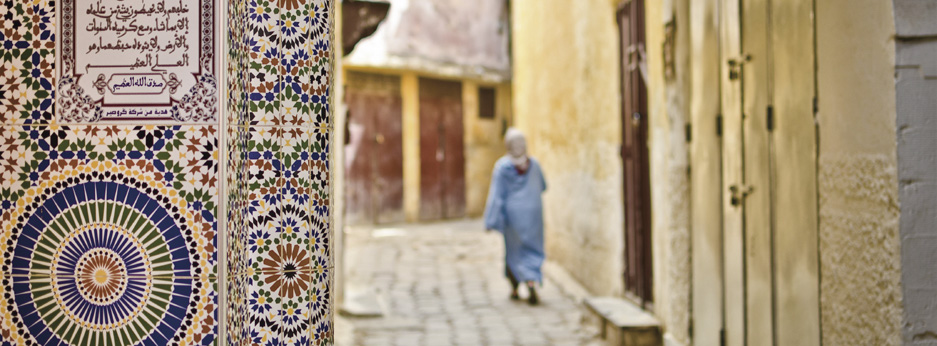 Street of Meknes with decorating tiles - courtesy of Cox and Kings