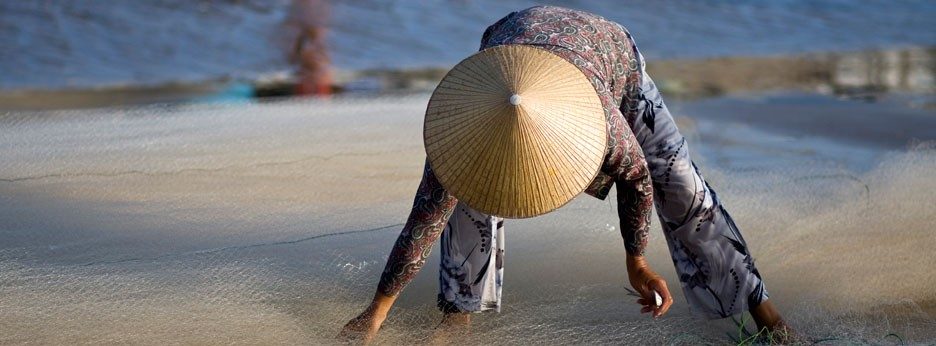 Woman fishing, Vietnam, courtesy of Indus Experiences