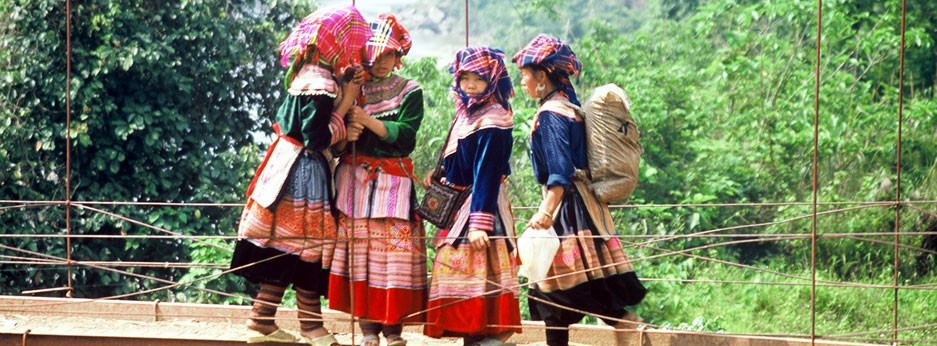 Indochina - girls on bridge -  courtesy of Indus Travel